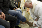 Pope Francis washes the foot of a prisoner at Casal del Marmo youth prison (Reuters)