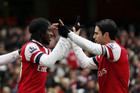Gervinho and Mikel Arteta (Reuters)