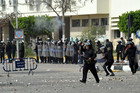 Egyptian security forces face protesters during clashes in Port Said, Egypt (AAP)