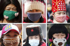 People wear face masks to protect themselves from the smog (Reuters)