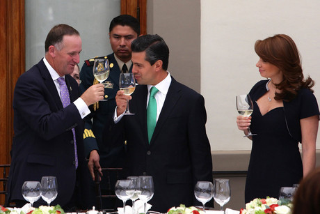 Prime Minister John Key (L), Mexican president Enrique Peña Nieto (C), and Mexican first lady Angelica Rivera (R) toast during a reception in Mr Key's honour at Chapultepec Palace, in Mexico City (AAP)
