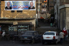 An election banner for an independent candidate hangs in Al Arafa, Egypt (Reuters)