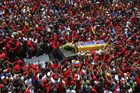 Mourners line the streets to pay their respects to Chavez (Reuters)