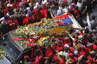 Hugo Chavez's coffin is driven through the streets of Caracas (Reuters)