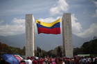 Supporters of Venezuela's late President Hugo Chavez walk past the Monument to the Founding Fathers to view his body (Reuters)