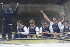 Oxford University's eight celebrate defeating Cambridge (Reuters)