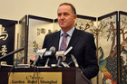 Prime Minister John Key fronts a press conference on the GCSB spying scandal in Shanghai, China (AAP)