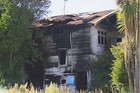 The burnt out Peterborough St property (3 News)