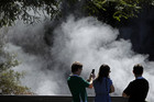 Tourists visit mud volcanoes and geysers at Wai-O-Tapu (Reuters)