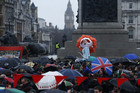 Protesters hold aloft a Thatcher puppet (Reuters)