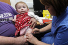 Lauren Durbin, aged 10 months, is given an MMR injection in Swansea, south Wales (Reuters)