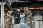 North Korean leader Kim Jong-un (2nd R) looks at combat and technical (Reuters/KCNA file)