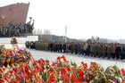 Soldiers, workers and students stand before the statues of North Korean founder Kim Il-sung and his son, late leader Kim Jong-il (Reuters)