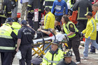 The aftermath of the blasts near the marathon's finish line on Boylston Str (AAP/Boston Herald)