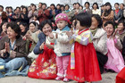 North Koreans attend celebrations in honour of first leaer Kim Il Sung (Reuters/KCNA)
