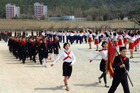 Students march at a camping site in Pyongyang to commemorate the 101st anniversary of the birth of North Korea's founder Kim Il-sung (Reuters)