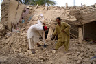Men search through the rubble of a destroyed house following an earthquake near the Iran border in Mashkel, Pakistan (AAP)