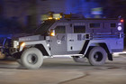 Police vehicles search neighborhoods (AAP)