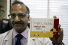 A doctor holds an Indian-made cancer drug (AAP)