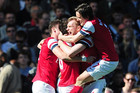 Arsenal's Per Mertesacker (centre) is mobbed by team-mates after scoring their first goal of the game (AAP)