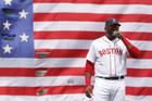 Boston Red Sox's David Ortiz addresses fans during a pre-game ceremony honoring the victims of the Boston Marathon bombings (Reuters)