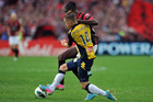 The Central Coast Mariners' Michael McGlinchey (left) is tackled by Kwabena Appiah Kubi of the Western Sydney Wanderers (Photosport)