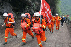 Rescuers run through wreckage to reach the isolated Baoxing county a day after an earthquake hit Ya'an, Sichuan province (Photo: Reuters)