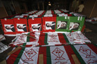 Political campaign banners and flags are laid out to dry at a workshop in Karachi, Pakistan (Reuters)