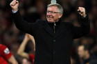 The master Sir Alex Ferguson is all smiles after claming his 13th EPL title (Reuters)