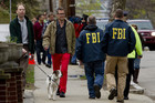 FBI officials carry out investigations in Boston (AAP)