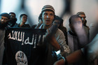 A defendant linked to al Qaeda holds a flag as a verdict upholding his and his co-defendants' jail sentence (Reuters)