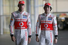McLaren Formula One drivers Jenson Button of Britain (L) and Sergio Perez of Mexico (Reuters file)