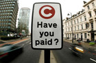 A congestion charge sign in London (Reuters)