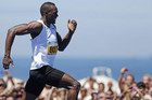 "Jamaican Olympic gold medallist Usain Bolt leaps ahead to win his first race of the 2013 season, the ""Mano a Mano Men's 150 metres"" challenge on Copacabana beach in Rio de Janeiro (Reuters)"