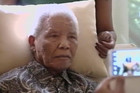 Nelson Mandela is photographed during his meeting with Jacob Zuma (Reuters)