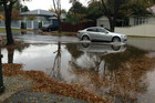 Water floods a Christchurch street (Photo: Simon Baker/Digiflicks)