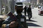 Afghan security officials stand guard after the attack (AAP)