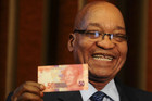 South Africa's president Jacob Zuma holds up a banknote bearing the face of former president Nelson Mandela (Reuters)