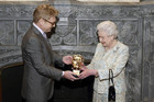 Actor Kenneth Branagh presents the Queen with her award (Reuters)