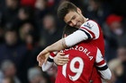 Olivier Giroud and Santi Cazorla (Reuters file)
