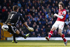 Tomas Rosicky fires a shot past Ben Foster (Reuters)