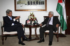Palestinian President Mahmoud Abbas (R) meets US Secretary of State John Kerry in the West Bank city of Ramallah (Reuters)
