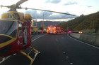 The Life Flight Rescue Helicopter waits to airlift a man to hospital near Lower Hutt (Photo: Life Flight Trust)