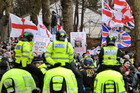 English Defence League members are watched by mounted police (AAP File)