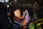 A woman is comforted by others at a refugee camp for Burmese Muslims  (Reuters)