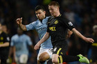 Sergio Aguero and James McCarthy battle it out for posession (Reuters file)