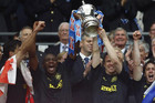 Wigan Athletic's Emmerson Boyce (L) and Gary Caldwell lift the trophy (Reuters)