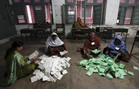 Election workers count ballots after polls closed for Pakistan's general elections in Peshawar (Reuters)
