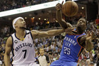 Oklahoma City Thunder guard DeAndre Liggins (25) goes to the basket against Memphis Grizzlies guard Jerryd Bayless (7) (Reuters)