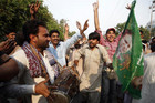 Supporters of Nawaz Sharif celebrate election results (Reuters)
